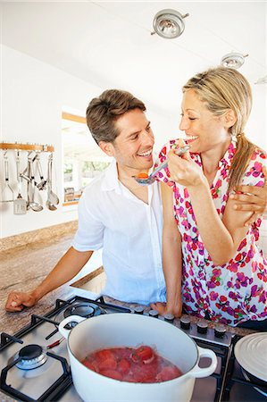 stove - Couple cooking together in kitchen Stock Photo - Premium Royalty-Free, Code: 649-04247670