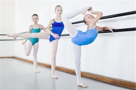 preteen dancing - Ballet dancers posing at barre Stock Photo - Premium Royalty-Free, Code: 649-04248011