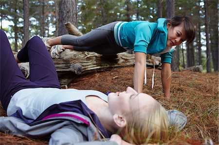 Women exercising together in forest Stock Photo - Premium Royalty-Free, Code: 649-04248354