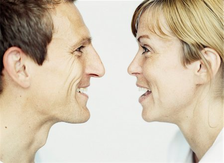 person silhouette face - Close up of couple laughing together Stock Photo - Premium Royalty-Free, Code: 649-04248642