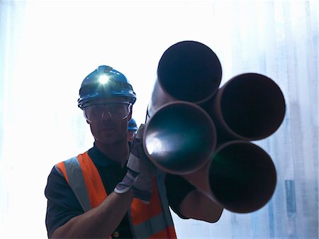pipe (industry) - Worker carrying pipes Stock Photo - Premium Royalty-Free, Code: 649-04248807