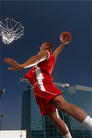 scoring - Basketball player about to dunk Stock Photo - Premium Royalty-Free, Code: 649-04248875