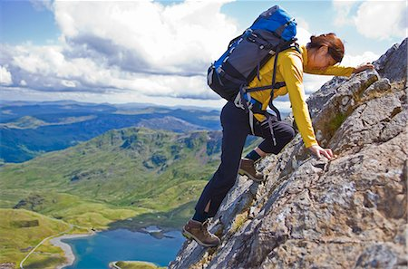 Woman climbing rocky mountainside Stock Photo - Premium Royalty-Free, Code: 649-04249157