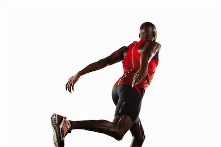 runner (male) - Athlete lunging Stock Photo - Premium Royalty-Free, Code: 649-04827177