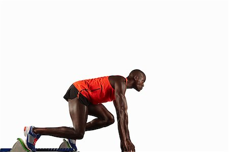 sprint - Runner crouched at starting line Stock Photo - Premium Royalty-Free, Code: 649-04827208