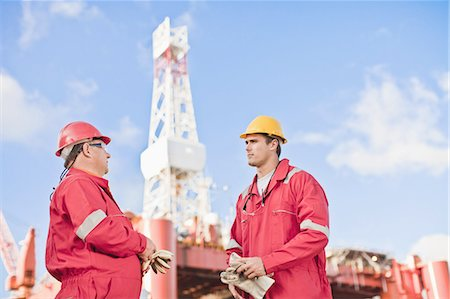 drilling - Workers talking on oil rig Stock Photo - Premium Royalty-Free, Code: 649-04827629