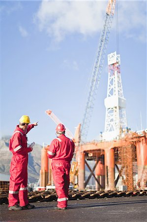 drilling - Workers talking on oil rig Stock Photo - Premium Royalty-Free, Code: 649-04827631