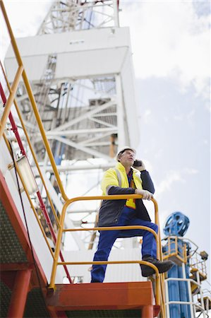 platform - Worker talking on cell phone on oil rig Stock Photo - Premium Royalty-Free, Code: 649-04827665