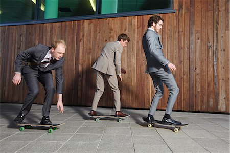 funky - Businessmen riding skateboards Stock Photo - Premium Royalty-Free, Code: 649-04827917