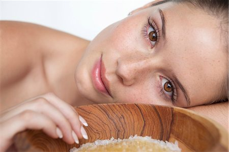 Woman laying by bowl of sugar Stock Photo - Premium Royalty-Free, Code: 649-05520803