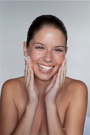 facial - Woman scrubbing sugar on her face Stock Photo - Premium Royalty-Free, Code: 649-05520827