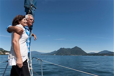 sailboat  ocean - Older couple standing on boat together Stock Photo - Premium Royalty-Free, Code: 649-05520980