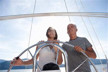Older couple sailing together Stock Photo - Premium Royalty-Free, Code: 649-05521013