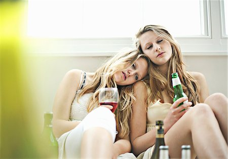 Drunken teenage girls dozing together Stock Photo - Premium Royalty-Free, Code: 649-05521088