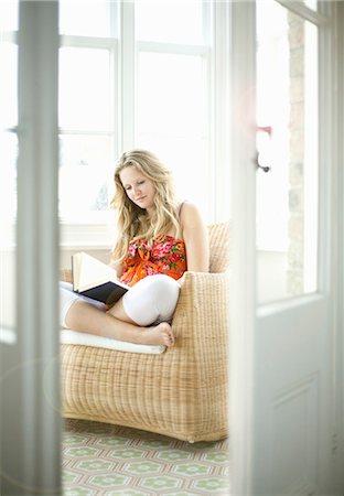 Girl reading in armchair Stock Photo - Premium Royalty-Free, Code: 649-05521083