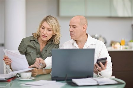 reviewing - Couple paying their bills at home Stock Photo - Premium Royalty-Free, Code: 649-05521370