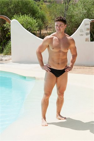 Man wearing tight swimsuit by pool Stock Photo - Premium Royalty-Free, Code: 649-05521406