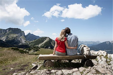 people sitting on bench - Couple sitting on bench on hilltop Stock Photo - Premium Royalty-Free, Code: 649-05521423