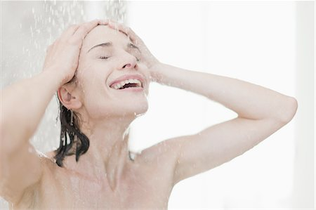shower - Smiling woman taking shower Stock Photo - Premium Royalty-Free, Code: 649-05521608