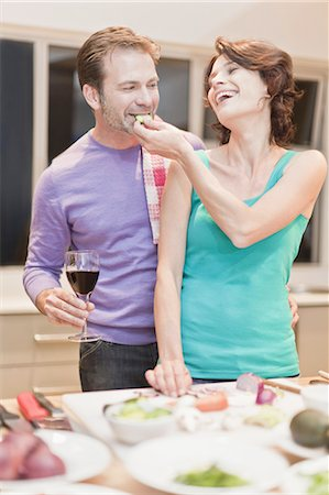 Couple eating and cooking dinner Stock Photo - Premium Royalty-Free, Code: 649-05521637
