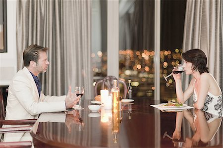 Couple having romantic dinner at home Stock Photo - Premium Royalty-Free, Code: 649-05521643