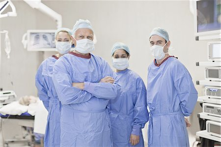Team of doctors in operating room Stock Photo - Premium Royalty-Free, Code: 649-05521759