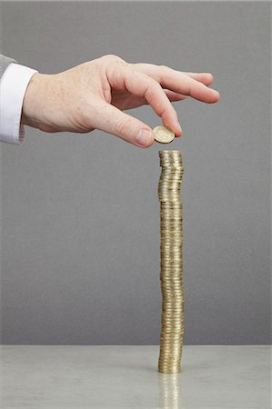 silhouette hand - Businessman making stack of coins Stock Photo - Premium Royalty-Free, Code: 649-05522030