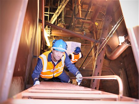 Engineer climbing staircase in ship Stock Photo - Premium Royalty-Free, Code: 649-05522193