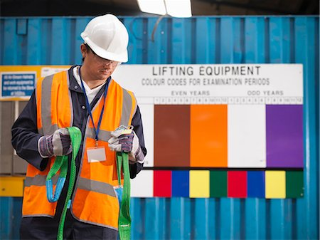 Worker examining safety rope on site Stock Photo - Premium Royalty-Free, Code: 649-05522228