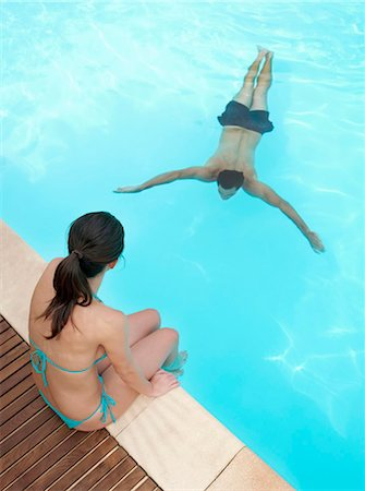 Couple relaxing in swimming pool Stock Photo - Premium Royalty-Free, Code: 649-05522347