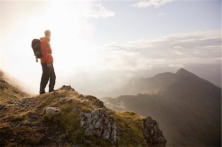 Hiker overlooking view from mountaintop Stock Photo - Premium Royalty-Free, Code: 649-05522388