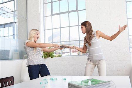Businesswomen fighting over papers Stock Photo - Premium Royalty-Free, Code: 649-05522435