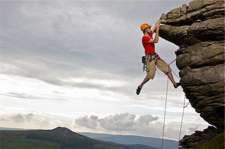 rock climber - Rock climber scaling steep rock face Stock Photo - Premium Royalty-Free, Code: 649-05522624