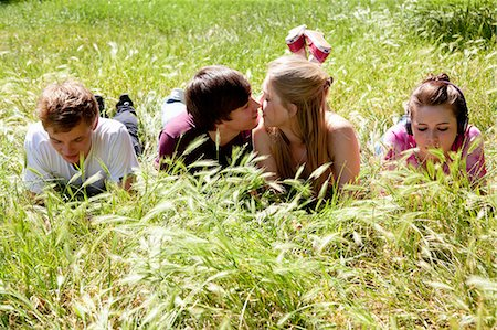 Teenagers ignoring kissing friends Stock Photo - Premium Royalty-Free, Code: 649-05555599