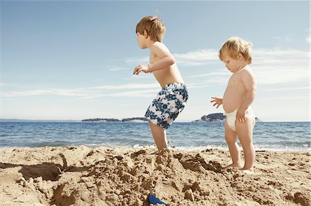 stamped - Children stomping on sandcastle Stock Photo - Premium Royalty-Free, Code: 649-05555923