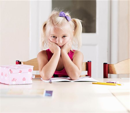 Bored girl doing homework at table Stock Photo - Premium Royalty-Free, Code: 649-05556124