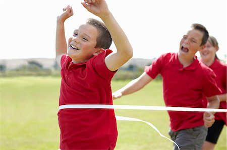 finish line - Boy cheering and crossing finish line Stock Photo - Premium Royalty-Free, Code: 649-05556195