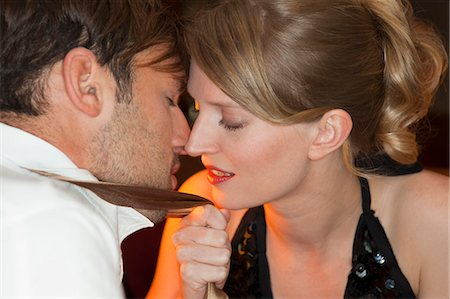 Couple touching noses in restaurant Stock Photo - Premium Royalty-Free, Code: 649-05556305