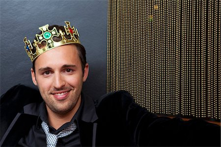 Smiling man wearing plastic crown Stock Photo - Premium Royalty-Free, Code: 649-05556314