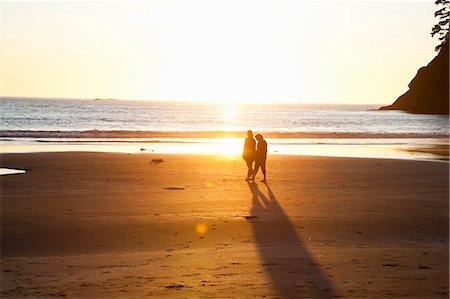 family active beach - Couple walking on beach on sunset Stock Photo - Premium Royalty-Free, Code: 649-05556548