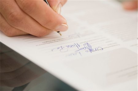 Close up of woman writing Stock Photo - Premium Royalty-Free, Code: 649-05648792