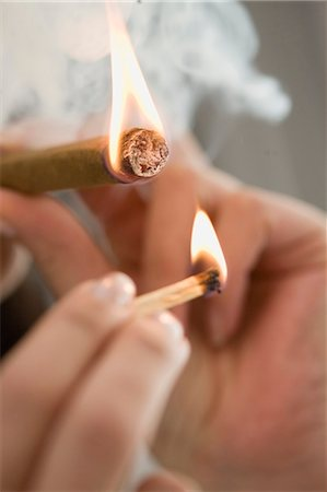 Close up of woman lighting cigarette Stock Photo - Premium Royalty-Free, Code: 649-05648808
