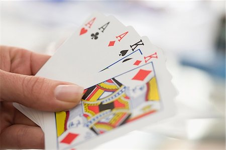 Close up of woman playing cards Stock Photo - Premium Royalty-Free, Code: 649-05648825