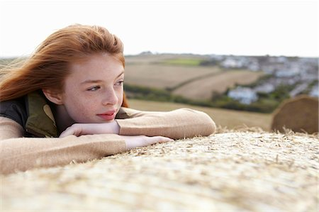red hair preteen girl - Teenage girl resting on haybale Stock Photo - Premium Royalty-Free, Code: 649-05649171