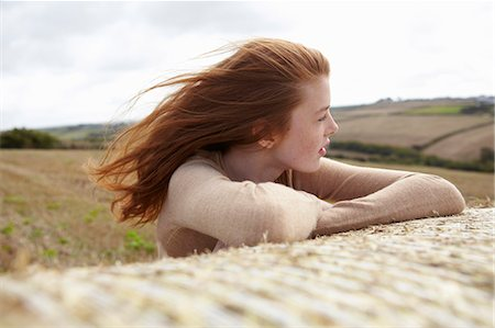 red hair preteen girl - Teenage girl resting on haybale Stock Photo - Premium Royalty-Free, Code: 649-05649172