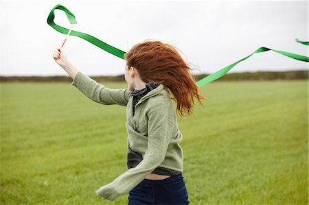 red hair preteen girl - Teenage girl playing with ribbon Stock Photo - Premium Royalty-Free, Code: 649-05649187
