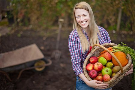 Woman gathering vegetables in garden Stock Photo - Premium Royalty-Free, Code: 649-05649199