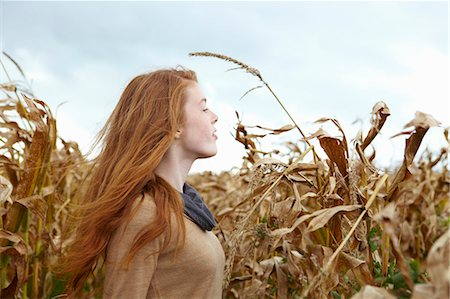 red hair preteen girl - Teenage girl walking in cornfield Stock Photo - Premium Royalty-Free, Code: 649-05649192