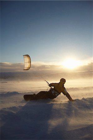 sports and snowboarding - Man windsurfing on snowboard Stock Photo - Premium Royalty-Free, Code: 649-05649629