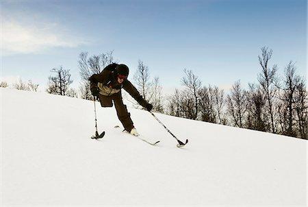 One-legged skier snowy slope Stock Photo - Premium Royalty-Free, Code: 649-05649631